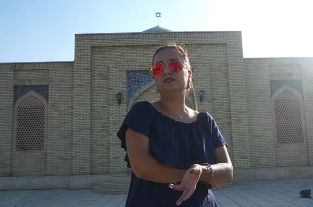Shirin Yakubov standing in front of Bukhara's Jewish cemetery, September 9,  2016. She