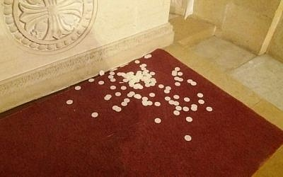 Eucharist bread scattered by vandals on the floor of the Basilica of the Transfiguration, October 25, 2016 (Courtesy)