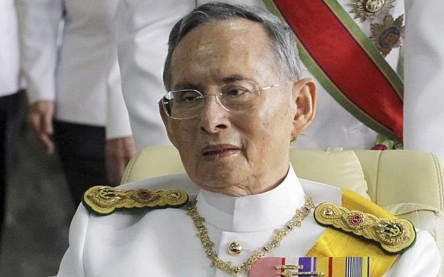 Thailand's King Bhumibol Adulyadej is pushed on a wheelchair while leaving Siriraj hospital for the Grand Palace for a ceremony celebrating his birthday in Bangkok, December 5, 2011. (AP Photo/Apichart Weerawong, File)