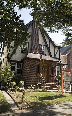 The exterior of a house in the Jamaica Estates neighborhood of the Queens borough of New York, where President Trump spent his early childhood, on October 18, 2016. (AP Photo/Mary Altaffer)