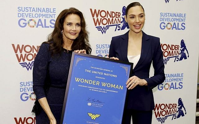 """In this image released by Starpix, actress Lynda Carter, who starred in the 1970s series,""""Wonder Woman,"""" left, and actress Gal Gadot, who stars in the upcoming film, """"Wonder Woman,"""" appear at a United Nations event naming the super hero character as an Honorary Ambassador For the Empowerment of Women and girls, Friday, Oct. 21, 2016, at the United Nations. (Marion Curtis/Starpix/AP)"""