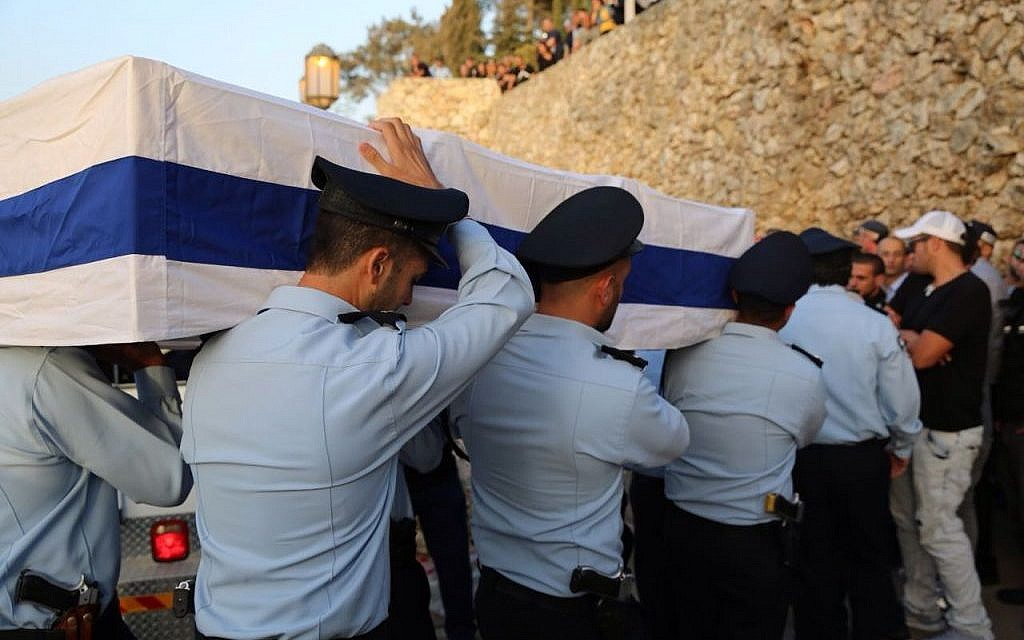 Police officers carry the coffin during the funeral on Jerusalem's Mount Herzl of police Sgt. Yosef Kirma who was killed in a terror attack earlier that day on October 9, 2016. (Israel Police)