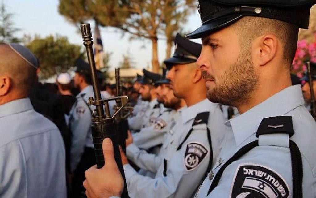 Police officers during the funeral on Jerusalem's Mount Herzl of police Sgt. Yosef Kirma who was killed in a terror attack earlier that day on October 9, 2016. (Israel Police)