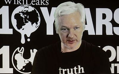 In this Oct. 4, 2016 photo, WikiLeaks founder Julian Assange participates via video link at a news conference marking the 10th anniversary of the secrecy-spilling group in Berlin. (AP Photo/Markus Schreiber, File)