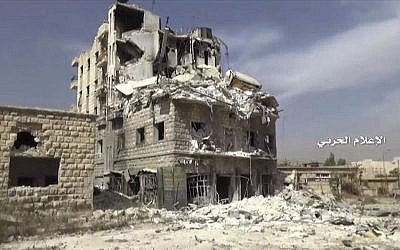 In this still image taken from video provided by the Syrian government-controlled Syrian Central Military Media, damaged buildings inside the Bustan Al-Basha neighborhood of Aleppo, Syria on Tuesday, Oct. 4, 2016. (Syrian Central Military Media via AP)