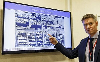 Einar Bjorgo, UNOSAT manager, shows a satellite image, taken on Sept. 26, 2016, of a destroyed road in a district in Aleppo, during a press conference at the European headquarters of the United Nations in Geneva, Switzerland, Wednesday, Oct. 5, 2016. (Salvatore Di Nolfi/Keystone via AP)