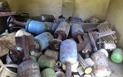 In this still image taken from video provided by the Syrian government-controlled Syrian Central Military Media, hand made bombs are seen inside the Bustan Al-Basha neighborhood of Aleppo, Syria on Tuesday, Oct. 4, 2016. (Syrian Central Military Media via AP)
