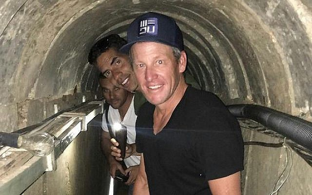 Lance Armstrong walks through a Hamas tunnel during a visit to Israel's Gaza border, October 2016 (Or Movement)
