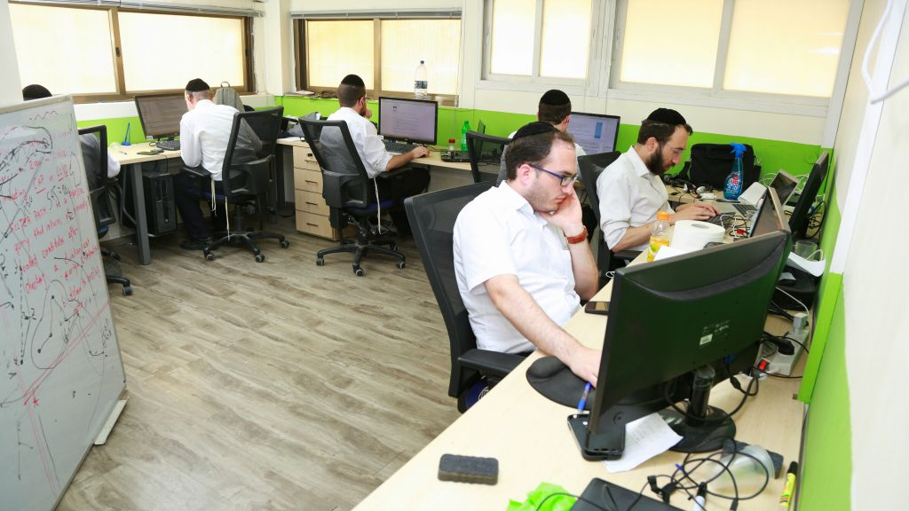 Ultra-Orthodox men at work at Ravtech (Courtesy)