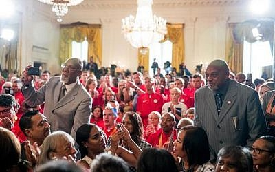 1968 US Olympic athletes Tommie Smith, right, and John Carlos, left, stand as they are recognized by President Barack Obama during a ceremony in the East Room of the White House in Washington, Thursday, Sept. 29, 2016. (AP Photo/Andrew Harnik)