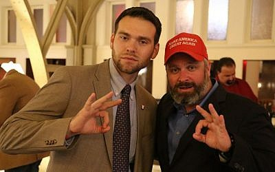 Alt-right radio personality Joe Biggs (right) poses with Jack Posobiec for a photograph in the atrium of Trump International Hotel in Washington, DC. (Eric Cortellessa/The Times of Israel)