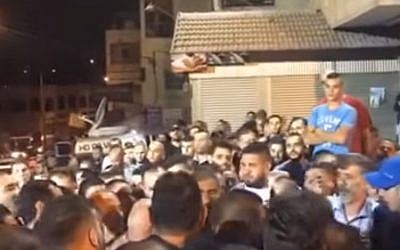 Celebrations outside the East Jerusalem home of the terrorist who murdered two Israelis October 9, 2016 (Screen capture: YouTube)