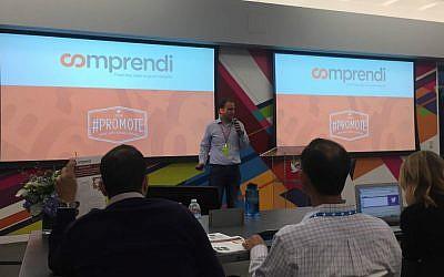 Comprendi's CEO Itai Ben-Zaken presents at Twitter competition (Courtesy)