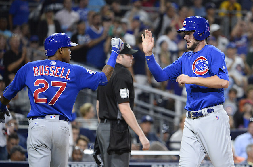 Addison Russell, left, with Cubs teammate Kris Bryant during the fifth inning of a game against the Padres at Petco Park in San Diego, Aug. 23, 2016. (Denis Poroy/Getty Images via JTA)
