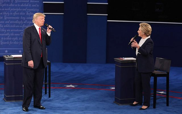Donald Trump, 2016 Republican presidential nominee, and Hillary Clinton, 2016 Democratic presidential nominee, speak during the second U.S. presidential debate at Washington University in St. Louis, Missouri, U.S., on Sunday, Oct. 9, 2016. (Daniel Acker/Bloomberg/Getty Images, via JTA)