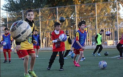 Jewish and Arab children in Jerusalem training together as part of the Kick It Out program to rid soccer of racism. (Yossi Zamir)