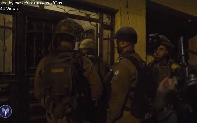 IDF troops at the home of a Hamas terrorist who led the October 2015 shooting attack that killed Eitam and Na'ama Henkin, on October 11, 2016. (IDF/Facebook screen capture)