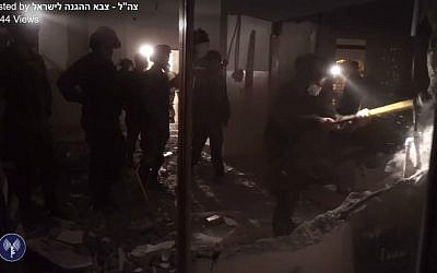 IDF troops destroy the home of a terrorist who led the October 2015 shooting attack that killed Eitam and Na'ama Henkin, on October 11, 2016. (IDF/Facebook screen capture)