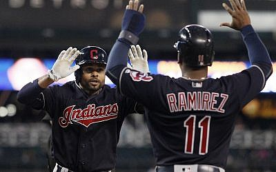Coco Crisp, left, celebrating with Cleveland teammate Jose Ramirez in a game against the Detroit Tigers at Comerica Park in Detroit, Sept. 26, 2016. (Duane Burleson/Getty Images via JTA)