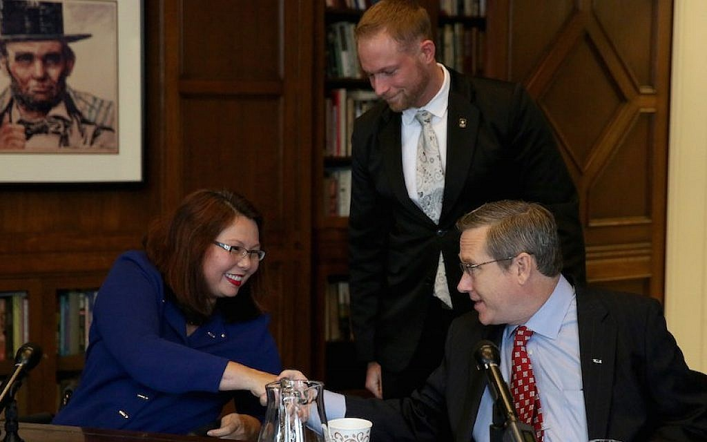 Rep. Tammy Duckworth and Sen. Mark Kirk shake hands after their debate on Monday Oct. 3, 3016 in the Chicago Tribune Editorial Board room. (Nancy Stone/Chicago Tribune/TNS via Getty Images via JTA)