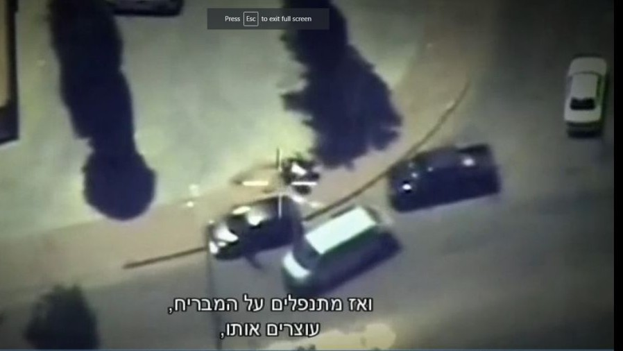 Border Police commandos in disguises dismount from a civilian pick up truck to arrest a smuggler near his home in a Bedouin community in southern Israel. (Screen capture Channel 10)