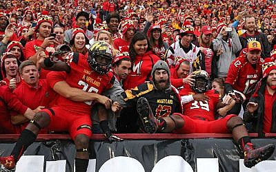 Some University of Maryland Terrapins players jumping into the stands before playing the Wisconsin Badgers at Byrd Stadium in College Park, Maryland, Nov. 7, 2015. (Patrick Smith/Getty Images via JTA)