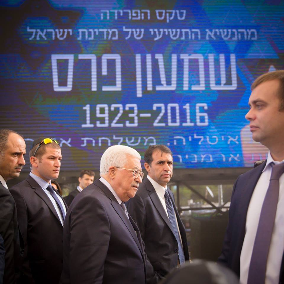 Palestinian Authority President Mahmoud Abbas, with colleagues and Israeli security (Elad Malka)