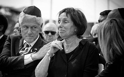 Bill Clinton comforts Shimon Peres's daughter Tzvia (Elad Malka)
