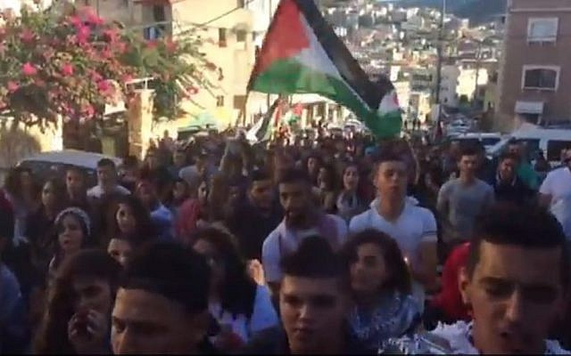 Israeli Arabs march in the town of Sakhnin on Saturday, October 1, 2016 to commemorate the deaths of 13 people killed in clashes with police during the Second Intifada.