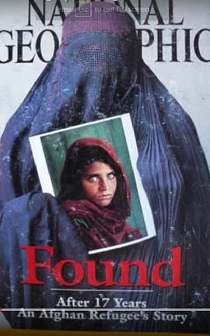 Sharbat Gula, relocated as a grown woman in a picture by SteveMcCurry published by National Geographic in April 2002. (YouTube screenshot of magazine cover)