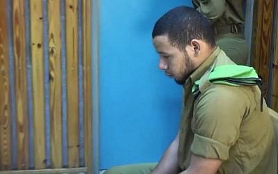 IDF soldier Fabio Sah-Kamal sits in a military court on October 5, 2016 after being convicted of accidentally killing his girlfriend (screen capture: Ynet)
