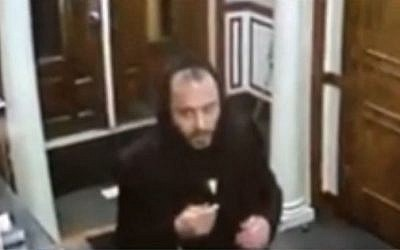 An unidentified man seen stealing four Torah scrolls from the  Avenue O Synagogue in Brooklyn, New York on October 25, 2016. (screen capture: