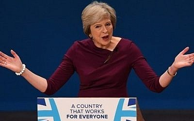 British Prime Minister Theresa May gestures as she delivers a keynote address on the final day of the annual Conservative Party conference in Birmingham, central England, on October 5, 2016.  (AFP PHOTO / PAUL ELLIS)