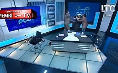A fierce exchange between Egyptian lawyer and controversial Australian cleric turns violent on live Egyptian television on September 26, 2016. (screen capture: YouTube, Middle East Media Research Institute)