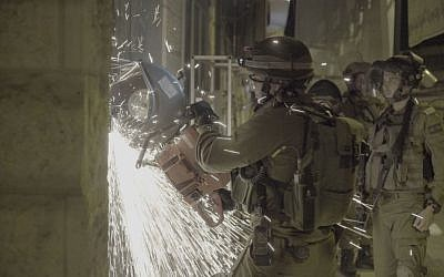Soldiers breaking open a print shop which the IDF said produced posters and other material supporting terror attacks, in al-Ram in the West Bank, October 19, 2016. (IDF Spokesperson)