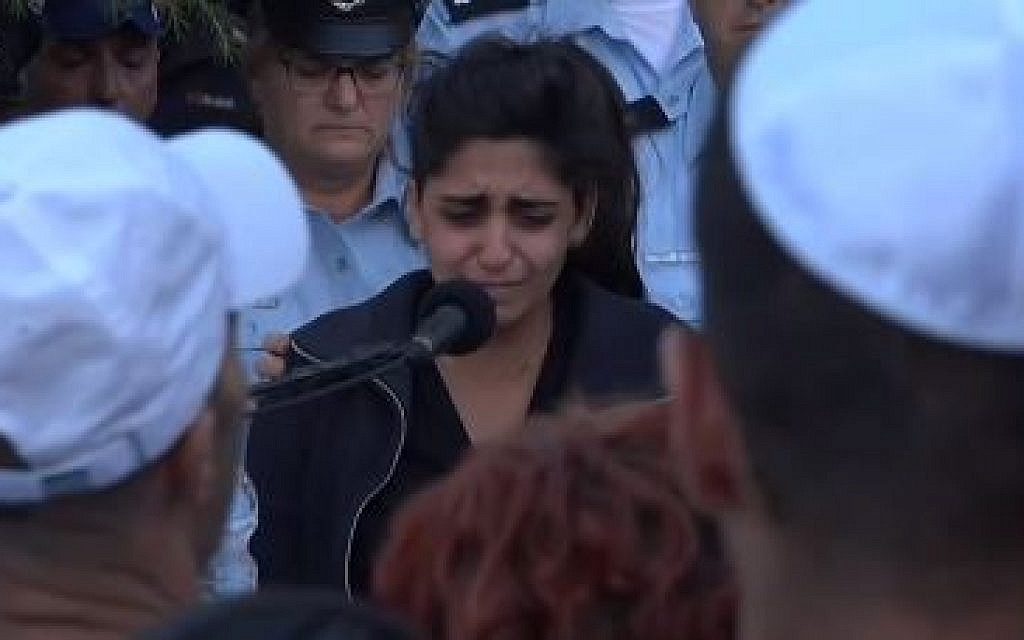 Noy Kirma speaking at the funeral of her husband First Sergeant Yossef Kirma who was killed during a terrorist attack in Jerusalem, October 9, 2016 (Screen capture: Ynet)