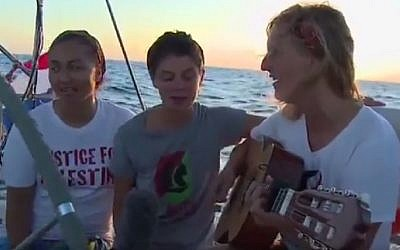 Women activists aboard the Zaytouna-Oliva sailboat headed for the Gaza Strip sing a song for Gaza. The boat was intercepted on October 5, 2016 by the Israeli Navy and escorted to the Israeli port of Ashdod. (Screenshot)