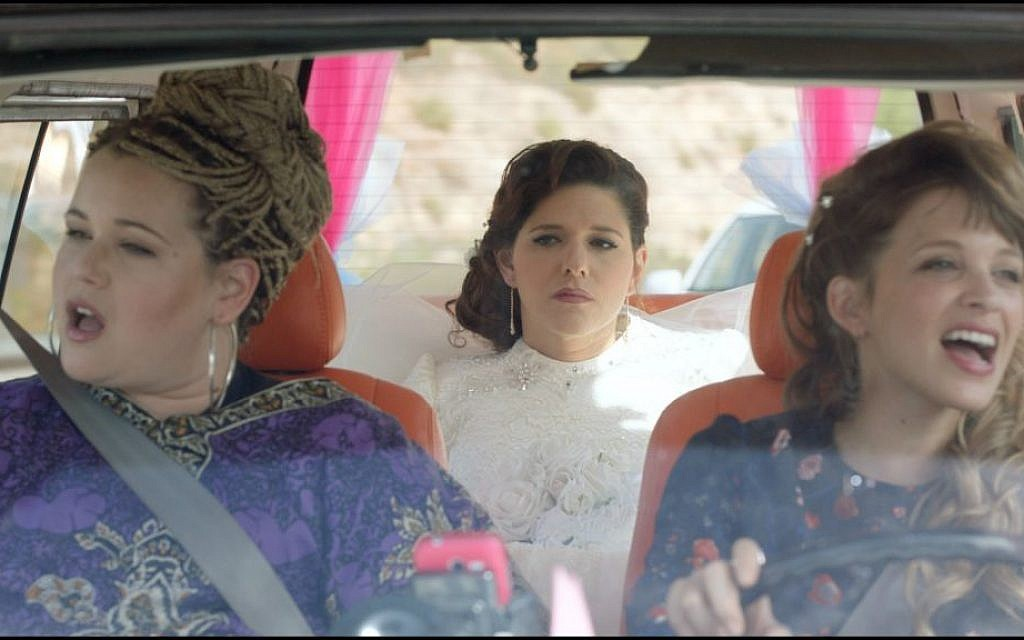 Michal, center, with her friend and sister on the way to her wedding in 'Through the Wall' (Courtesy 'Through the Wall')
