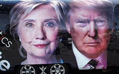A TV van with pictures of both candidates is seen outside the hall where the first presidential debate at Hofstra University's David & Mack Sport and Exhibition Complex in Hempsted, New York on September 26, 2016. The first US presidential debate, between Democratic candidate Hillary Clinton and Republican Donald Trump, is one of the high points of the campaign, six weeks from the November 8 elections. (Jewel SAMAD/AFP)