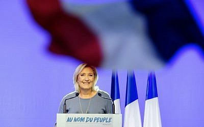 Marine Le Pen delivering a speech on stage behind a French national flag during the FN's summer congress in Frejus, southern France on September 18, 2016. (AFP / Franck PENNANT)