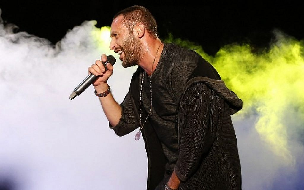 Arab-Israeli rapper Tamer Nafar performs on-stage during a festival in the northern Arab-Israeli town of Sakhnin on October 23, 2016. (AFP PHOTO / AHMAD GHARABLI / TO GO WITH AFP STORY BY MAJEDA El-BATSH)