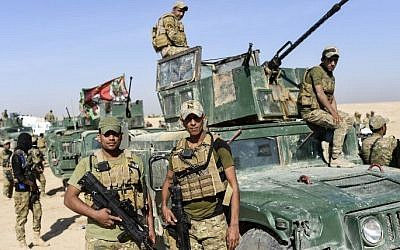 (FILES) This file photo taken on October 21, 2016 shows forces from Iraq's elite Rapid Response Division, which is at the forefront of the southern advance on Mosul, are deployed near the village of Tall al-Tibah, some 30 kilometers south of the jihadist-held city. (Bulent Kilic/AFP)