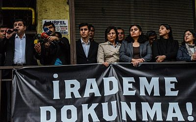 Pro-Kurdish People's Domocratic Party leader Selhattin Demirtas (L) stands behind a banner reading 'Do not touch my will' as he addresses a demonstration in Diyarbakir on October 28, 2016 following the arrest of the two co-mayors. (AFP/Ilyas Akengin)