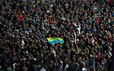 Protesters wave the Amazigh (Berber) flag as they shout slogans in the northern city of Al Hoceima on October 30, 2016, following the death of fishmonger Mouhcine Fikri, who was crushed to death on October 28 in a rubbish truck in Al Hoceima. (AFP PHOTO/FADEL SENNA)