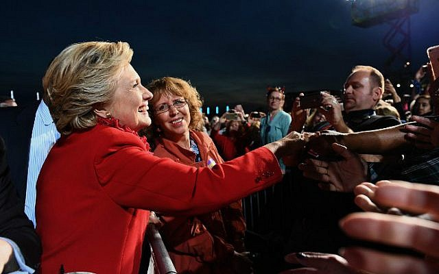 US Democratic presidential nominee Hillary Clinton greets supporters during a campaign rally in Cincinnati, Ohio on October 31, 2016. (Jewel Samad/AFP)