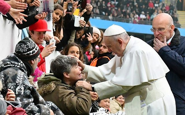 Pope Francis greets a handicapped wellwisher as he arrives at the Swedenbank Stadion in Malmo, Sweden, where he is to hold a mass on November 1, 2016. Francis is on a two-day visit to Sweden to mark the 500th anniversary of the Reformation.  (AFP PHOTO / VINCENZO PINTO)