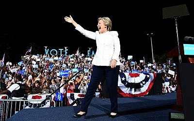 US Democratic presidential nominee Hillary Clinton waves to supporters during a campaign rally in Fort Lauderdale, Florida, on November 1, 2016.  (AFP/ Jewel SAMAD)