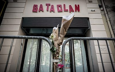 "This file photo taken on November 01, 2016 shows flowers tied to a fence outside the ""Bataclan"" concert hall, one of the targets of the November 13, 2015 terrorist attacks during which 130 people were killed and another 413 were wounded ( AFP PHOTO / PHILIPPE LOPEZ)"