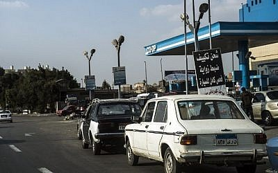 Cars queue at a petrol station in the Egyptian capital Cairo on November 4, 2016. The government announced an increase in fuel prices, with low grade petrol increasing by 50 percent to 2.35 pounds a liter while higher octane fuel rose by about one third to 3.5 pounds per liter. (Khaled Desouki/AFP)