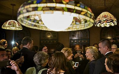 Democratic presidential nominee Hillary Clinton speaks with patrons at Miller's Bar on November 4, 2016 in Dearborn, Michigan. (AFP PHOTO / Brendan Smialowski)
